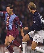 [ image: Villa defender Gareth Barry holds off the challenge of Jordi Cruyff]