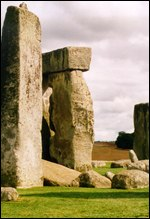[ image: The face can be seen on the side of a standing stone]