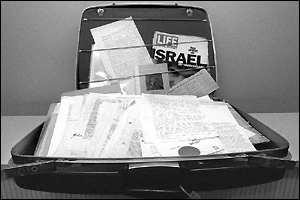 [ image: Schindler's documents, stored in one of the earliest models of Samsonite hard-shell suitcases]