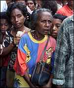 [ image: East Timorese wait for relatives who fled to return]