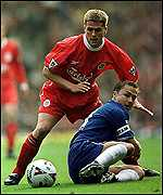 [ image: Red card man Dennis Wise fails to beat Michael Owen]