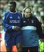 [ image: Desailly is led away]