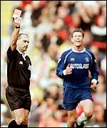 [ image: Chris Sutton is unimpressed by Mike Reed's red card for Dennis Wise]