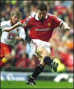 [ image: Defender Dennis Irwin fires home from the penalty spot]
