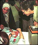 [ image: Ms Bellamy was shown a vaccination programme at a Baghdad children's hospital]