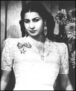 [ image: A scarf worn by Egyptian musical legend Umm Kalthoum is on sale]