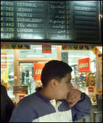 [ image: An Egyptian boy waits anxiously for news at Cairo airport]