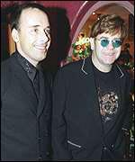 [ image: Star guests: Sir Elton John with partner David Furnish]