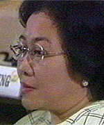 [ image: Megawati listens to the result being announced in parliament]