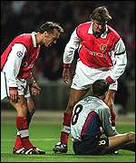 [ image: Arsenal's Tony Adams (right) and Lee Dixon accuse the grounded Cocu of diving to win a penalty]