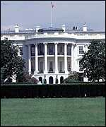 white house with garden in the fore