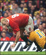 [ image: Joe Roff gets the better of Scott Quinnell]