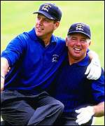[ image: Stewart (left) lost his Ryder Cup singles match to Colin Montgomerie]