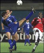 [ image: Mario Cvitanovic hacks the ball clear of United's Dwight Yorke]