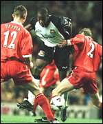 [ image: Paulo Wanchope finds no way past Stephane Henchoz and Sami Hyypia]