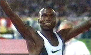 image: [ Wilson Kipketer celebrates beating Seb Coe's 16-year-old record ]