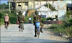 image: [ Soldiers on bicycles patrol an area of Jaffna ]