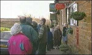 image: [ The queues outside Great Brington Post Office started before the shop opened ]