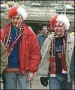 [ image: Stevenage fans in party mood]