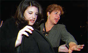 image: [ Monica Lewinsky fights her way through a media scrum ]