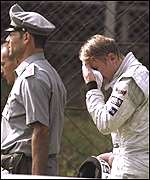 [ image: A distraught Hakkinen is overcome with emotion at Monza]