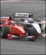 [ image: Hakkinen tussles with Schumacher at the controversial Malaysian GP]