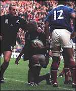 [ image: Jonah Lomu careers through a sea of French bodies for his first try]