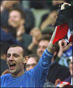 [ image: A French fan roars his team on to victory at Twickenham]
