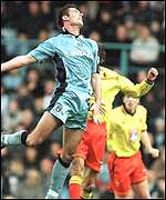 [ image: City on top: On-loan Belgian Cedric Roussel heads clear for Coventry]