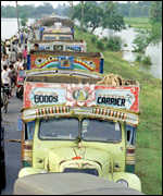 [ image: Abandoned vehicles on one of Orissa's main roads]