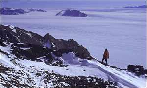 [ image: Rocky bluffs in Antarctica overlook the sea ice]