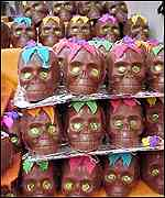 [ image: Day of the Dead markets sell chocolate skulls]