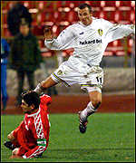 [ image: Lee Bowyer rides a Russian tackle]