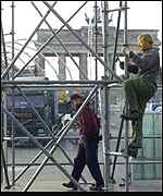 [ image: Workmen put up platforms for the party]