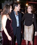 [ image: Pierce Brosnan with fiancee Keely Shaye Smith (left) and Rene Russo]