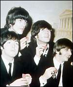 [ image: Winning formula: Lennon and fellow Beatles collect their MBEs]
