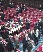 [ image: Peers file out in sombre mood]