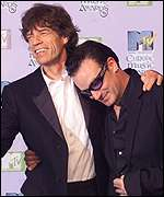 [ image: Rolling Stone Mick Jagger congratulates Bono on his award]