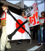 [ image: Protestors are angry that the Rising Sun flag has legal status]