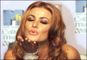 [ image: Baywatch babe Carmen Electra helped hand out awards .... and kisses]