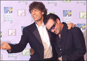 [ image: Proving the older stars still have it: Rolling Stone Mick Jagger congratulates U2's Bono for his Free Your Mind award]