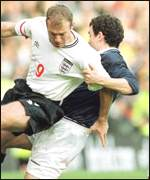 [ image: England captain Alan Shearer (left) tries to turn]