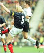 [ image: Michael Owen and Colin Hendry clash in mid-air]