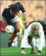 [ image: Paul Ritchie clashes with David Beckham]