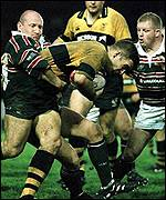 [ image: Joe Worsley of Wasps is halted by Derek Jelley]