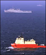 [ image: The US Grapple, top, and salvage ship Carolyn Chouest]