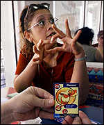 [ image: Shortage: LA mum-of-four Ruth Alhaj is trying to collect the 57 Burger King Pokemon toys]