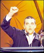 [ image: Triumphant: Robbie won three prizes at this year's Brit Awards]