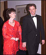[ image: Heading for trouble: Blair and wife Cherie arrive at the summit]