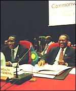 [ image: Inside the conference hall, Mugabe (left) looked jovial]
